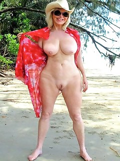 Mature pussy on beach